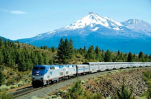 photo of Amtrak train with volcano in background